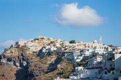 Santorini - The panorama of Fira and Firostefani at morning Stock Photos