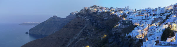 Santorini - The panorama of Fira morning dusk and Firostefani at morning dusk. Royalty Free Stock Photography