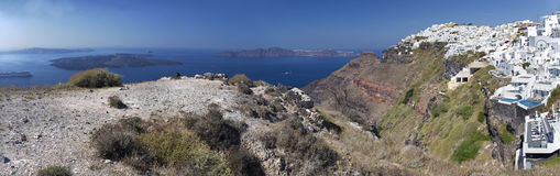 Santorini - The panorama of Imerovigli, Scaros, Therasia and Nea Kameni islands in the background. Royalty Free Stock Photo
