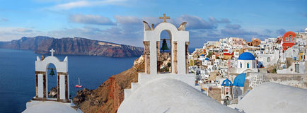 Santorini - The panorama of Oia and the Therasia island in the b Stock Photos