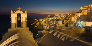 Santorini - The panorama of Oia and the Therasia island Royalty Free Stock Image