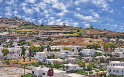 Santorini panorama, Greece. A panoramic image from Santorini village Emporio with houses and old windmills, Greece Royalty Free Stock Photos
