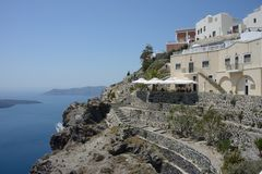 Santorini panoramic view with sea and some buildings with restaurant. On a mountain stock image
