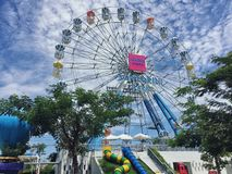 Santorini Park, an interesting Greek theme parks and amusement parks in Thailand. The colorful ferris wheel stock photo