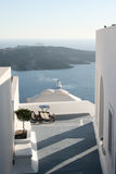 Santorini patio. A view of a passageway and patio overlooking the coastline of Santorini Island, Greece stock image