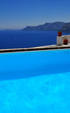 Santorini by the pool Royalty Free Stock Photo