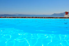 Santorini by the pool royalty free stock photography