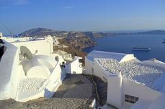 Santorini steep cobbled street down to sea  Royalty Free Stock Image