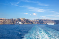 Santorini - pumice cliffs of calera with the cruises. Royalty Free Stock Image