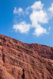 Santorini - Red pumice layers and sky. Stock Image