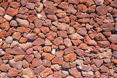 Santorini - Red pumice wall Stock Images