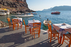 Santorini - The restaurint in Amoudi harbor of Oia in evening light. Royalty Free Stock Photo
