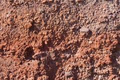 Santorini - rote Bimssteinschichten Stockfotografie