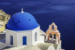 Santorini scene with famous blue dome churches Royalty Free Stock Photo