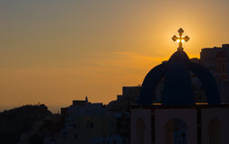 Santorini - The silhouett of typically church cupolas in Oia in the sunset. Sun Royalty Free Stock Photo