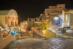 Santorini - The street of Oia with the souvenirs shops and restaurants at night. Stock Photo