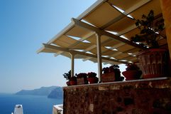Santorini Structure. Exterior of a structure with a row of assorted potted plants on a ledge Stock Image