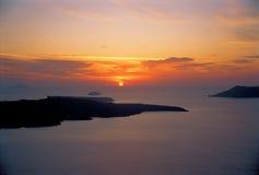 Santorini sunset. Sunshine over Santorini volcano in Greece Stock Photos