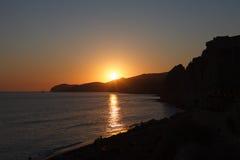 Santorini Sunset. Beautiful sunset at Santorini island, Greece. View from the Red Beach Royalty Free Stock Photo