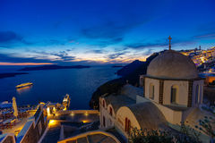Santorini sunset and St. John's cathedral Stock Images
