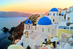 Santorini at sunset Stock Photos