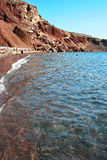 Santorini: Tourists at the Red Beach, one of its most famous and beautiful beaches Royalty Free Stock Photo