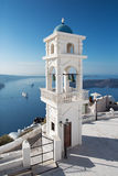 Santorini - The tower of Anastasi church in Imerovigli with the Nea Kameni island Stock Photos