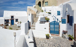 Santorini - typically aisle with he flowers in Oia. Stock Image
