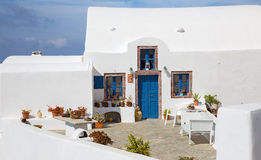 Santorini - typically little house and yard with he flowers in Oia. Royalty Free Stock Images