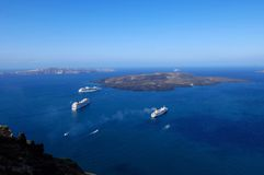 Santorini view. Boats in a bay on Santorini island, Greece Royalty Free Stock Images