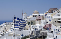 Santorini view with flag. And with white houses Stock Image