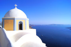 Santorini views, Greece. Traditional white church overlooking the blue sea, Santorini, Greece Royalty Free Stock Photography
