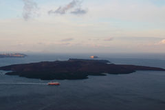 Santorini volcanic island in the sunrise Stock Photos
