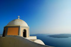 Santorini Volcano View. Church in Santorini, Greece, with a view of a volcano Royalty Free Stock Photo