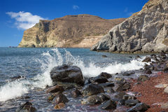 Santorini - waves on the Red beach from south part of the island. Royalty Free Stock Images