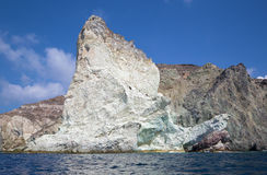 Santorini - white rock tower from south part of the island. Royalty Free Stock Photos