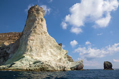Santorini - white rock tower from south part of the island. Stock Photography