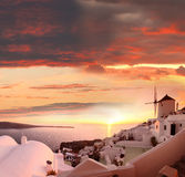 Santorini with windmill in Oia, Greece Stock Photo