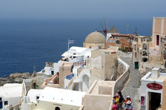 Santorinian view with greek flag. Royalty Free Stock Photos
