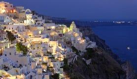 Santorinieiland bij nacht stock afbeelding
