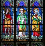 Santos sobre el vidrio manchado Imagen de archivo libre de regalías