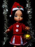 Santy doll , a doll wear santa dress. On black background stock images