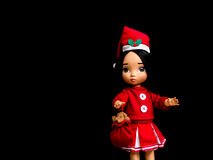 Santy doll , a doll wear santa dress. On black background royalty free stock images