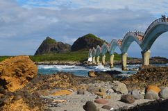 Sanxiantai`s eight-arched bridge on Taiwan`s East Coast National Scenic Area. The eight-arched bridge in Sanxiantai, near to the town of Chenggong, has become a Royalty Free Stock Photos