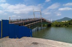 New pedestrian bridge is built across the Linchun River bank in the city of Sanya Stock Images