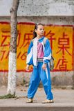 Young adorable girl wearing school uniform, Sanya, Hainan Island, China. SANYA-JAN. 11, 2012. Young girl wearing school uniform. Local school uniforms are always Stock Photography