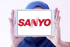 Sanyo logo. Logo of electronics manufacturer sanyo on samsung tablet holded by arab muslim woman Royalty Free Stock Photos