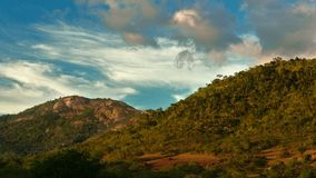 End of golden hour, São José Hill, Feira de Santana, Bahia, Brazil. Scene of two hills seen from a distance. The hills are covered by trees and are under a stock photo
