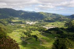 Sao Miguel island and village. Sao Miguel island landscape in the Portuguese Azores archipelago with a few villages in a valley Royalty Free Stock Photography