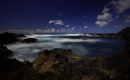 Sao Miguel rock beach with blue waterIncredible blue ocean water near Sao Miguel islans, Azores royalty free stock photos